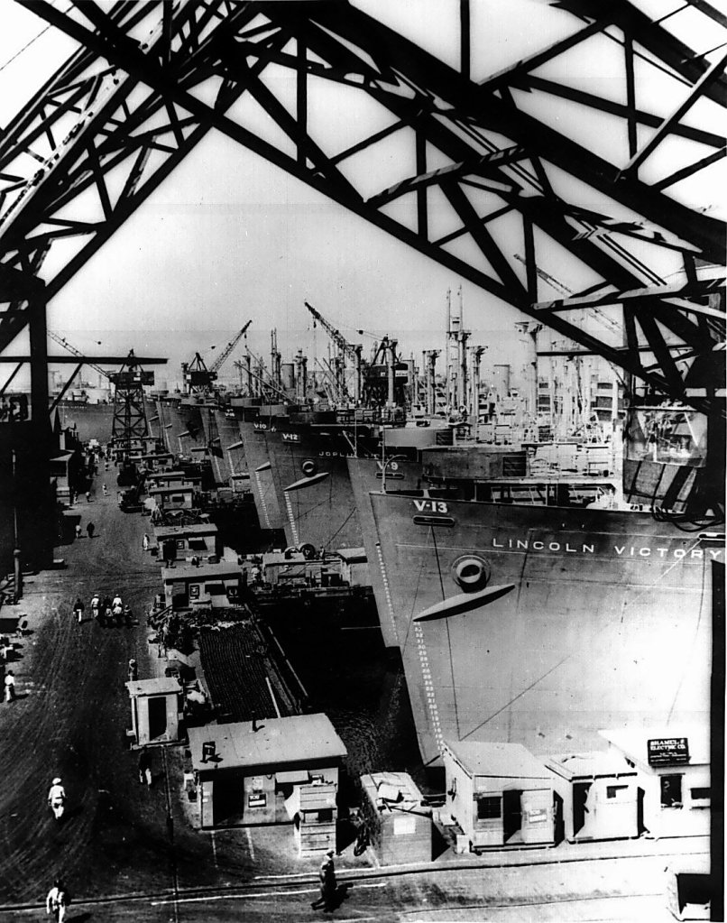 Victory_cargo_ships_are_lined_up_at_a_U.S._west_coast_shipyard